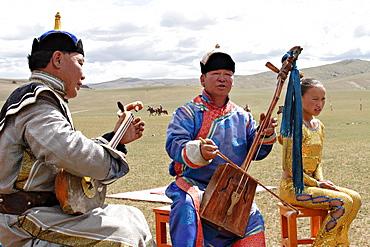 Mongol Musicians and Acrobat at Naadam Festival, Kharakhorin, Central Mongolia.