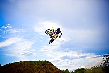 A motocross biker performs a whip during a jump in Brainerd, Minnesota.