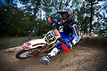 Motocross biker leans into a sharp turn in Brainerd, Minnesota.