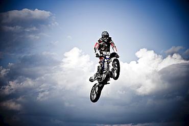 A motocross biker sails through the clouds in Brainerd, Minnesota.