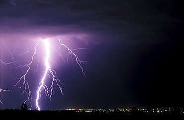 A large lighting bolt lights up the sky as it strikes near Fort Collins Colorado.