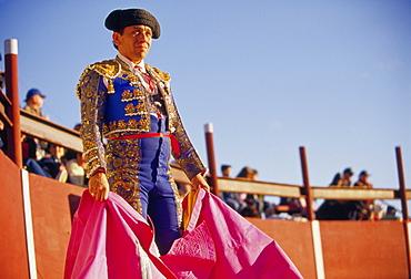 A matador waits for his bull to enter the ring.