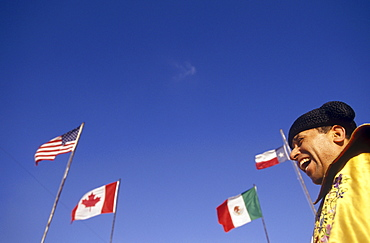 Matador stands underneath the flags of USA, Canada, Mexico and the State of Texas before the start of a bullfight.