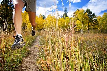 a woman trail running near gold hill, co.