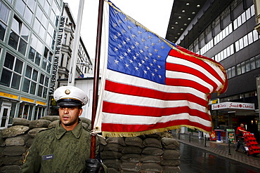 """Pictured is a member of the association: """"Geschichte lebendig vermitteln"""" (bringing history to life) at Checkpoint Charlie (former crossing point of the Allied forces), who is representing an American guard, Berlin, October 01 2009."""