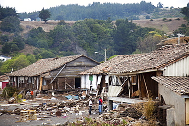 Houses are destroyed in Curanipe, Chile after an 8.8 earthquake and subsequent tsunami struck this coastal town.