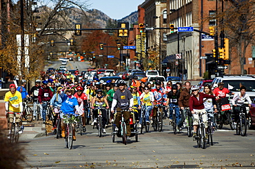 A mass of people ride bicycles along Broadway in downtown Boulder, during a rally and demonstration against coal plants and to raise awareness of global warming, on the international day of action promoted by 350.org, October 24, 2009, in Boulder, Colorad