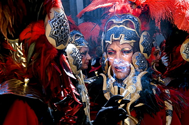 Women dressed in elaborate costumes, loosely representing the North African tribes, the Moors, smoke cigarettes before marching in a parade during the Festival of Moors and Christians, in the old town of Alcoy, Alicante Province, Valencia Autonomous Regio