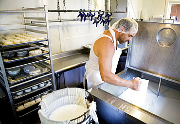 A man makes goat cheese at Beltane Farm in Lebanon, Connecticut.