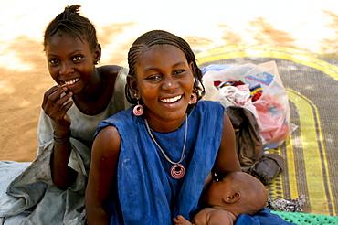 A young African Toureg mother nurses her newborn baby, Gossi, Mali, West Africa