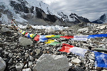 Prayer flags wave in the wind at Mt. Everest base Camp.