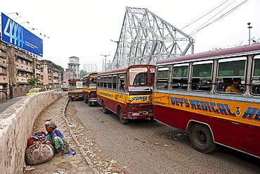 City buses in front of Howrah Bridge, Calcutta, India.