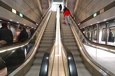 Commuters ride the escalator and board subway trains in Copenhagen, Denmark. Scandinavia.