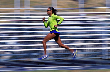 Yvonne Joyce running on a track in Vail, Colorado.