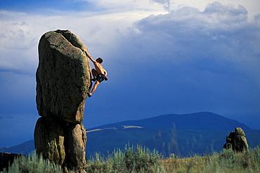 Alek Tkach bouldering in Whiskey Gulch, Montanta.