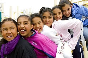 Palmira Gonzalez-Jiminez is surrounded by her best buddies in the playground at Harrington Elementary School in Denver, Colorado. A man tried to abduct Palmira in a nearby park last month. Her friends all ran to her aid hitting and kicking the man. The girls are L to R Irma Belmontes, Crystal Palacios, Melina Sandoval, Palmira Gonzalez-Jiminez,   Sandra Ibarra, Lorena Luna.