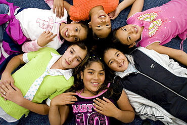 Palmira Gonzalez-Jiminez is surrounded by her best buddies at Harrington Elementary School in Denver, Colorado. A man tried to abduct Palmira in a nearby park last month. Her friends all ran to her aid hitting and kicking the man. The girls are clockwise starting with Palmira Gonzalez-Jiminez in center (Baby GIrl shirt), Lorena Luna,  Crystal Palacios,  Irma Belmontes, Melina Sandoval,  Sandra Ibarra.