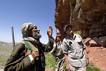 A local hunter, Abdul Rahim, discusses wild animals and their habitat with a wildlife biologist, Dr. George Schaller and his assistant, who are conducting a wildlife survey, in the Band-e Baba range, Herat Province, Afghanistan