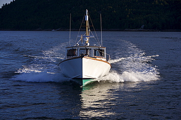 A Stanley designed Downeaster, a classic Maine fishing boat, motors in Sommes Sound, Mt. Desert Island, Maine.  Mt Desert Island is the home of Acadia National Park