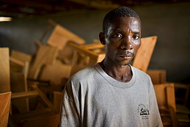 Portrait of a young Liberian man, Thomas Grant, in a carpentery workshop. After the long civil war employment opportunities remain few and capacity building a priority.