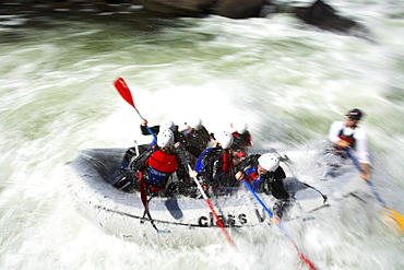 Pan blur image of unknown rafters roll through the infamous Pillow Rock rapid on the Upper Gauley River near Fayetteville, WV