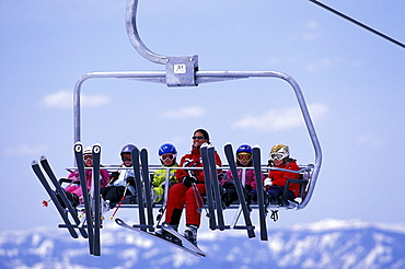 Heavenly Ski Instructor Danielle Ledesma riding the chairlift above Lake Tahoe with her class of young students at Heavenly Mountain Resort in South Lake Tahoe, California.