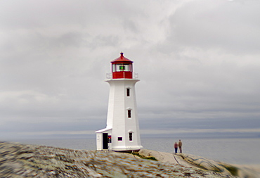 Peggy's Cove near Halifax Nova Scotia. This is an old fishing town. It is one of the closest points to where the Titanic sunk. Survivors were brought to Halifax about 30 miles from Peggy's Cove.When ocean cruise ships dock in Halifax Peggy's Cove is a day trip for some of the travelers before returning to the ship.  A lighthouse is perched on the edge of Peggy's Cove
