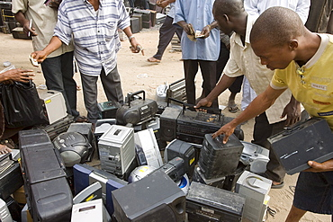 Alaba Market, Lagos Nigeria. Many of the computers here are second hand and shipped from Asia, the USA or Europe for reuse. The small shop dealers buy electronics from the containers and are very good at repairing the goods for sale. Only when material has no value is it sent to nearby dumps.
