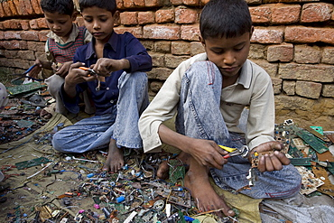 A village named Muftaffabad Loni on the outskirts of New Delhi, India that specializes in recycling circuit boards from electronics. The boards are taken out of electronics in other areas of New Delhi. Some of the boards are burned, some are dipped in sulfuric acid to get the metals separated from the plastics.