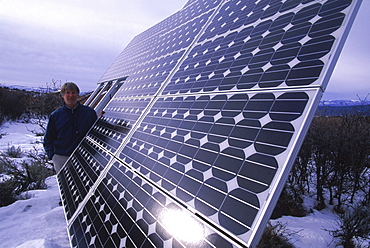 Randy Udall of CORE monitors one of his solar panels.