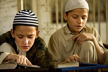 Young boys study the Koran at a madrassa in Karachi, Pakistan on February 1, 2008.