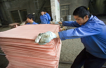 Chinese workers labor at a copper smelter in Tongling in China's central Anhui Province. The smelter refined some of the metals that will be used in the 2008 Summer Olympic medals to be held in Beijing.