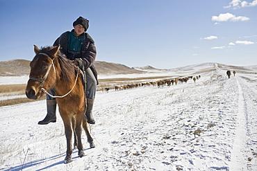 Davit Gareja, Georgia - January, 2008: Shepherd and his folk in the snowy mountains near the Azeri border with Georgia.