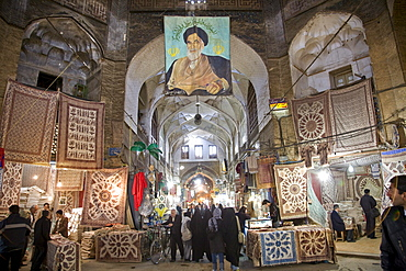 Esfahan, Iran - February, 2008: Portrait of the Ayatolloah Khomeini in Bazar-e Bozorg (Great Bazaar), a massive covered bazaar off of Imam Square in Esfahan, Iran  which dates back almost 1300 years.