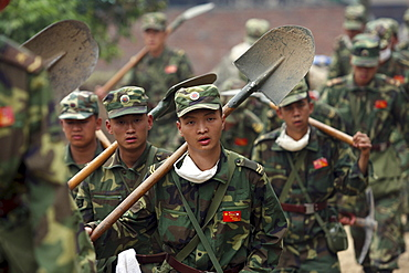 Chinese military descend upon Beichuan town to provide relief after Monday's earthquake. The Chinese government raised the death toll to 21,500 but has said fatalities could rise above 50,000. Tens of thousands could still be buried in collapsed buildings in Sichuan province, where the quake was centered.