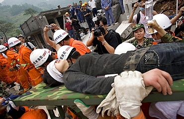 Earthquake survivor Bian Gangfen directly after she was rescued from the rubble of a collapsed building in Yinghua.