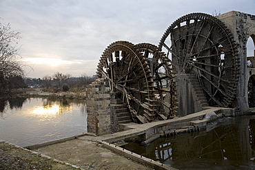 Hama, Syria - January, 2008: Norias - waterwheels up to 20 m in diameter have been used in Hama since the 5th century century to help transport water.