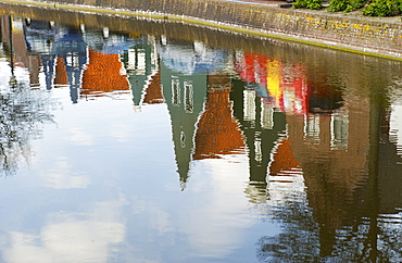 Reflections of houses in a canal, Alkmaar, Netherlands.
