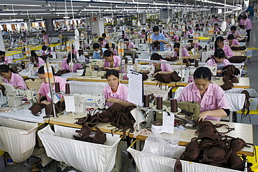An overview of Chinese seamstresses at work, sewing bras in the Top Form factory in Longnan, China