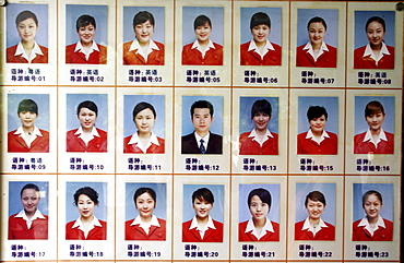 A sign shows the photos of tour guides at a tourist site in Guilin, China.