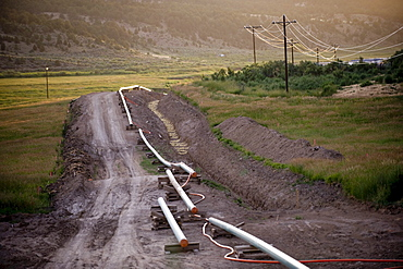 A natural gas pipeline is set to buried in the bottom land along Piceance Creek, in the Piceance Basin, CO.  The Piceance Basin and the adjoining Roan Plateau are at the center of Colorado's energy boom.