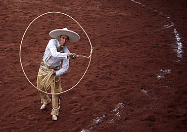 A Mexican Charro uses a lasso as he competes in a Charreria, or rodeo, Mexico's national sport,  in Texcoco, Mexico, October 28, 2007.