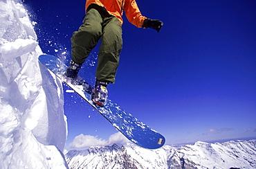 Snowboarder Stephen Koch on a Burton Snowboard at Snowbird