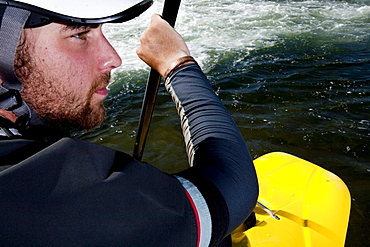 Close-up of a kayaker's face while paddling the Clark Fork River, Missoula, Montana.
