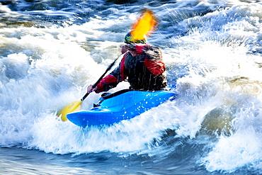 A male kayaker battles rapids on the Clark Fork River, Missoula, Montana.