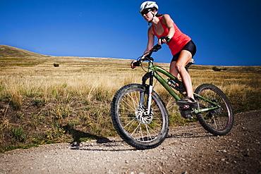 A female mountain biker pedals the trail on Mt. Sentinel, Missoula, Montana.