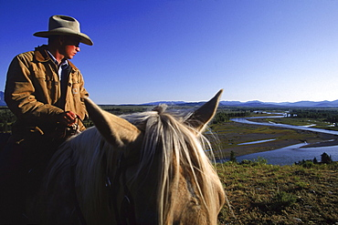Trail rides out of Lost Creek Ranch with Snake River in background.