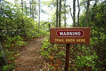 Trail warning sign reading