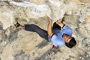 A rock climber ascends a steep rock face in Mexico.