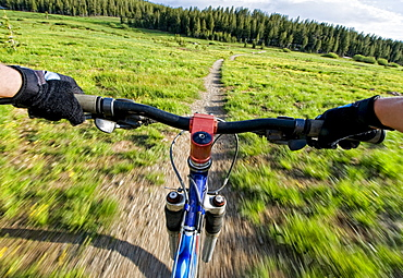 A young woman catches a quick mountain bike ride before the sun goes down in Lake Tahoe, Nevada.